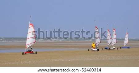 Panoramic of land sailing on the beach of Ouistreham in the Calvados department in the Basse-Normandie region of France - stock photo