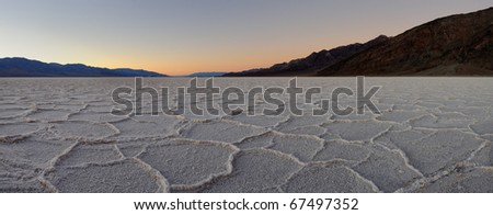 Panoramic of sunset at the Badwater salt pan in Death Valley National Park, California