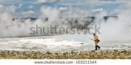 Panoramic of  Yellowstone Ranger Walking by Volcanic Fumes