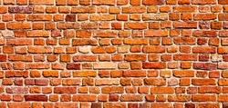 Panoramic Old Red Brick Wall Background. Beautiful Vintage Brickwall Texture. Wide Angle Grunge Web banner or Wallpaper With Copy Space.