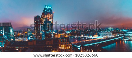 panoramic overview of london landscape with skyscrapers and Blackfriars Bridge at night
