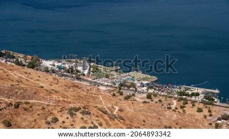 Panoramic overview of the beautiful Sea of Galilee and the city of TIberias in Israel