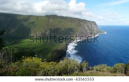Panoramic overview of the Hawaiian coastline of Waipio Valley, Big Island, Hawaii.