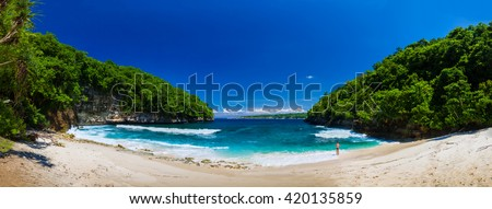 Panoramic photo azure lagoon tropical island / Tropical beach in Bali with rocky mountains and clear water of Indian ocean at sunny day / Bali, Indonesia