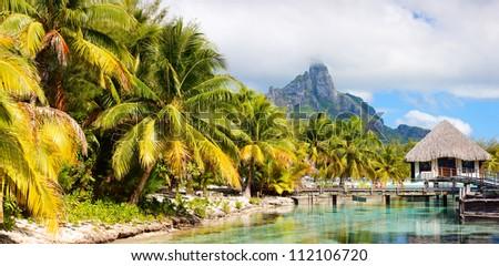 Panoramic photo of beautiful Bora Bora island landscape with Otemanu maintain on background - stock photo
