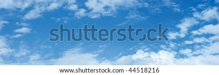 Panoramic photo of blue sky and clouds pattern copy space, cloudscape panorama