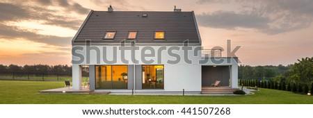 Panoramic photo of elegant and modern house with big backyard #441507268