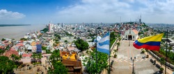 Panoramic photo of Guayaquil, Ecuador, South America, with flag and church from the mirador.