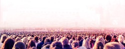 Panoramic photo of large crowd of unrecognizable people. Slow shutter speed with motion blur.