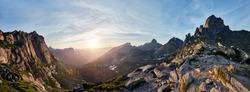Panoramic photo of the spring mountain valley natural Park Ergaki, Russia. Fabulous sunrise and sunset in the mountains, amazing nature, spring in the mountains. Travel and hike