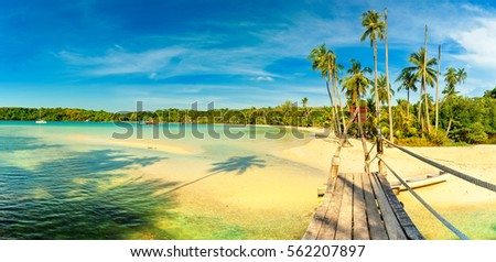 Panoramic photo tropical beach / Scenery wooden bridge to the tropical beach with green palm trees and azure lagoon clear ocean water Gulf of Siam / Asia, Thailand