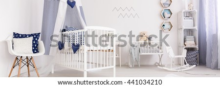 Panoramic picture of a crib in a cozy baby room