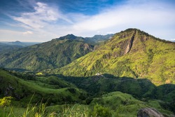 Panoramic picture of Beautiful Morning at little Adams peak in Ella Scenic peak reachable by steps & a moderate hiking trail, offering picturesque sunrise views, Sri Lanka.