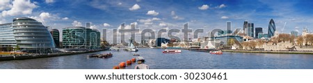 Panoramic picture of City of London with lots of tourists (including City Hall, Gherkin, Tower 42, and HMS Belfast).