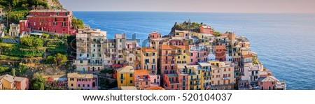 Panoramic picture of famous town of Manarola in Cinque Terre / Colorful houses of Liguria under vanilla sky / Mediterranean villages in Italy