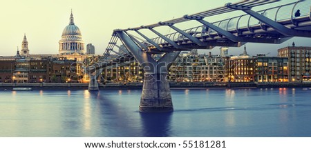 Panoramic picture of St Paul's Cathedral and Millennium Bridge at night.