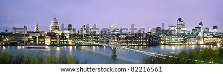 Panoramic picture of St. Paul's Cathedral, Millennium Bridge and  the Financial District at twilight.