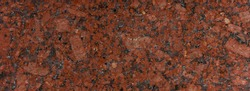 Panoramic red granite surface. Texture background for graphic applications