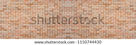 Panoramic red orange old brick wall pattern texture background. Wide panorama of masonry