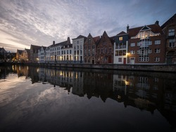 Panoramic reflection view of river canal channel in historic city center Bruges West Flanders Flemish Belgium Europe