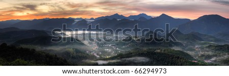 Panoramic rural scenery sunrise with samll town in hill and forest, Taiwan, Asia.