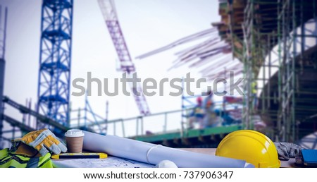 Panoramic shot of architecture equipment on table against work in progress in the city #737906347