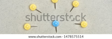panoramic shot of pins symbolizing victim and abusers on grey background #1478575514