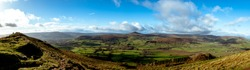 Panoramic shot of Sugar loaf in the distance with beautiful welsh scenary around it taken from skirrid fawr south wales uk.