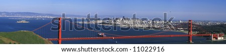 Panoramic shot of the Golden Gate Bridge in San Francisco with the view of the city, the bay and Alcatraz in the background