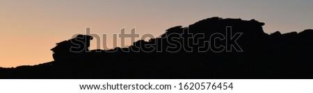 Panoramic silhouette of Kilmar Tor Bodmin Moor at twilight