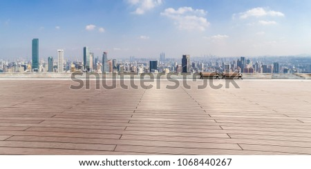 Panoramic skyline and buildings with empty concrete square floor  #1068440267