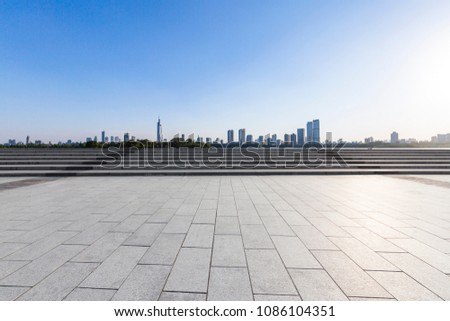 Panoramic skyline and buildings with empty concrete square floor #1086104351
