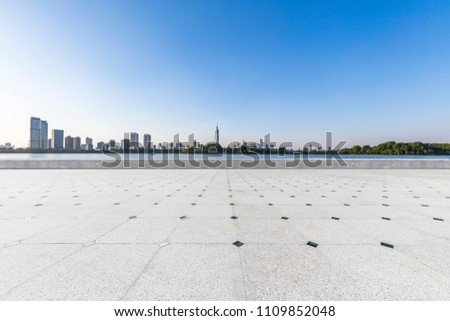 Panoramic skyline and buildings with empty concrete square floor #1109852048