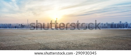 Panoramic skyline and buildings with empty concrete square floor #290930345