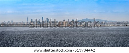 Panoramic skyline and buildings with empty concrete square floor #513984442
