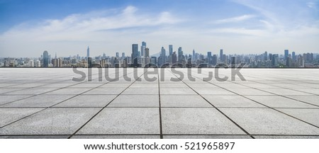 Panoramic skyline and buildings with empty concrete square floor #521965897