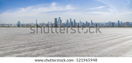 Panoramic skyline and buildings with empty concrete square floor #521965948
