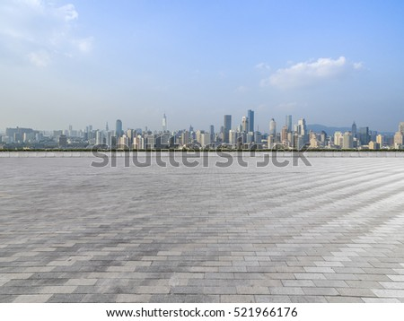 Panoramic skyline and buildings with empty concrete square floor #521966176