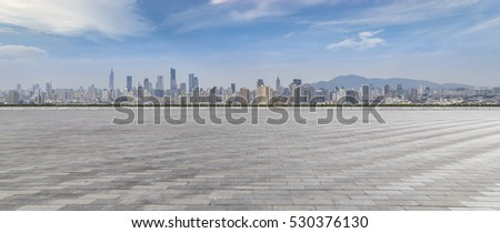 Panoramic skyline and buildings with empty concrete square floor #530376130