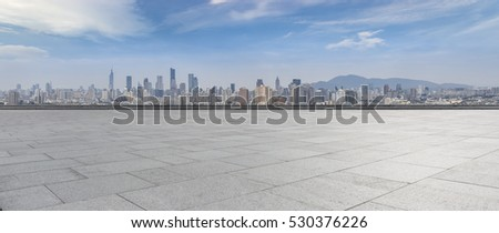 Panoramic skyline and buildings with empty concrete square floor #530376226