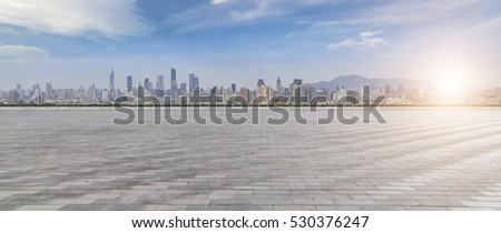 Panoramic skyline and buildings with empty concrete square floor #530376247