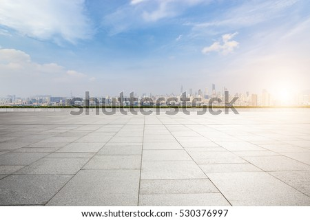 Panoramic skyline and buildings with empty concrete square floor #530376997
