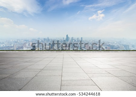 Panoramic skyline and buildings with empty concrete square floor #534244618