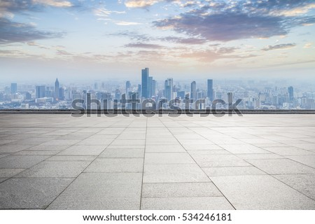 Panoramic skyline and buildings with empty concrete square floor #534246181