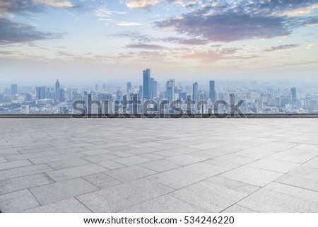 Panoramic skyline and buildings with empty concrete square floor #534246220