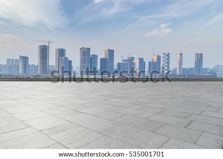 Panoramic skyline and buildings with empty concrete square floor #535001701