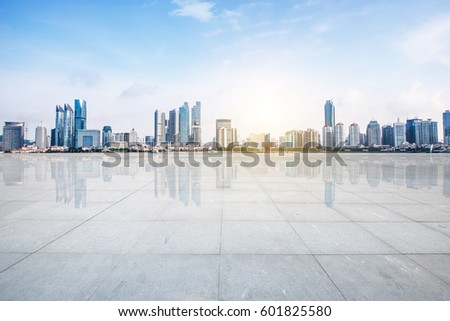 Panoramic skyline and buildings with empty concrete square floor