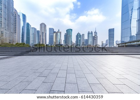 Panoramic skyline and buildings with empty concrete square floor #614430359