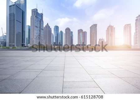 Panoramic skyline and buildings with empty concrete square floor #615128708