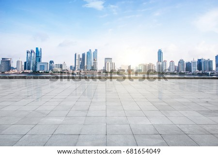 Panoramic skyline and buildings with empty concrete square floor #681654049